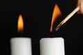Candle being lit match burning candle background Stock Photos