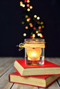 Candle and books dreams love magic light heart bokeh lights background concept of stories unusual Royalty Free Stock Image