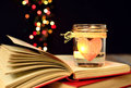 Candle and books dreams love magic light heart red bokeh lights background concept of stories unusual Stock Photography
