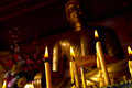 Candle with buddha statue candel the in pose to win the mara Royalty Free Stock Photo
