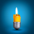 Candle bulb into lighting blue background Royalty Free Stock Photo