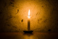 Candle burning grungy wall background vignette Royalty Free Stock Photo
