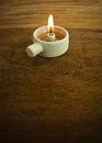 Candle candlelight on old wooden background Royalty Free Stock Photo