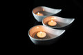 Candle in ceramic bowl iii container over black background Stock Photography