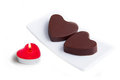 Candle and chocolates in the shape of heart Royalty Free Stock Photo
