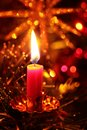 Candle and christmas decorations on christmas tree Stock Image