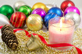 Candle and christmas ornament Royalty Free Stock Image