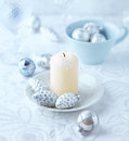 Candle and christmas ornements on a table shallow dof Royalty Free Stock Photos