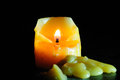 Candle in the darkness. Royalty Free Stock Photo