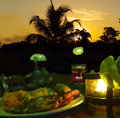 Candle dinner, sunset romance. Royalty Free Stock Photo