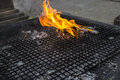 The candle fire and joss stick on metal sieve Stock Photos