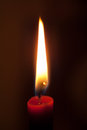 Candle flame the of a burning red Royalty Free Stock Image