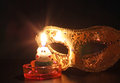 Candle flame closeup of mask with Stock Photography