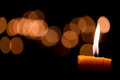 Candle flame light at night with bokeh on dark background Royalty Free Stock Photos