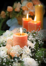 Candle on floral background