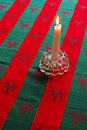 Candle on Holiday Tabletop Royalty Free Stock Images
