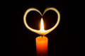 Candle light heart shape in the dark night Royalty Free Stock Image