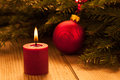 Candle light with red bauble Royalty Free Stock Image