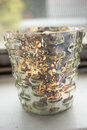 Candle in a mercury glass votive Royalty Free Stock Photo