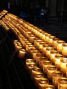 Candle of prayer in cathedral Royalty Free Stock Photography