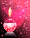 Candle romance beautiful glass on pink background with a bright flame Royalty Free Stock Photo