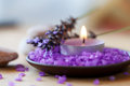 Candle in a saucer with salt baths and sprigs of lavender Stock Photography