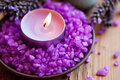Candle in a saucer with salt baths and sprigs of lavender Royalty Free Stock Photo