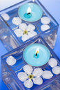 Candle with spring flowers Royalty Free Stock Photo