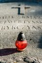 A candle on the tombstones red with christ Royalty Free Stock Image