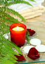 Candle, towels, stones and petals. Stock Image