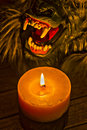 Candlelight illuminating the werewolf face hdr effect two toned close up Royalty Free Stock Photo