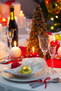 Candlelight on a table decorated beautifully for christmas in home Stock Photo
