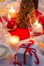 Candlelight on a table decorated beautifully for christmas in home Royalty Free Stock Images