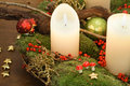 Candles and advent wreath a pair of in a green Stock Images