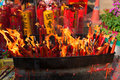 Candles on a buddhist altar for the chinese new year prayer blazing uncontrollably alter to commemorate lunar in bangkok thailand Royalty Free Stock Image