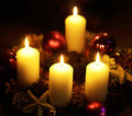 Candles burning on christmas wreath Stock Photography