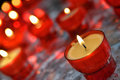 Candles in catholic church firing closeup image Royalty Free Stock Photo