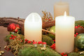 Candles and christmas wreath a green decorative Royalty Free Stock Photo