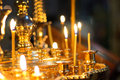 Candles at church on golden stand Stock Images
