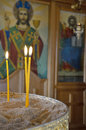 Lighting candles in the church Royalty Free Stock Photo