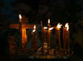 Candles and cross in the orthodox ukrainian church Royalty Free Stock Photo