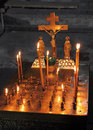Candles and crucifix in church kanun remembrance table with Royalty Free Stock Photos