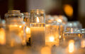 Candles in glas jar lit glass jars at an altar Royalty Free Stock Images