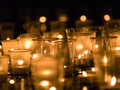 Candles group of several on dark background Royalty Free Stock Photos