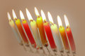 Candles on hanukkah a silver candlestick with colorful picture at close range room rental jewish renewal sanctification Royalty Free Stock Photos