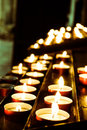Candles inside church lots of a dark Royalty Free Stock Photo
