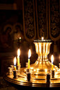Candles and a lamp burning in the church. Royalty Free Stock Photography