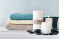 Candles with lavender flowers and towels two on light blue background Royalty Free Stock Image