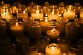 Candles lit glowing in a church Stock Photo