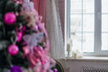 Candles near the window and blured Christmas tree on a foreground Royalty Free Stock Photo